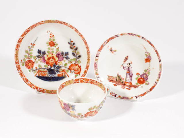 A Meissen teacup and saucer and another saucer, circa 1725