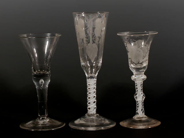 An opaque-twist ale glass and two wine glasses, circa 1770 and 1740