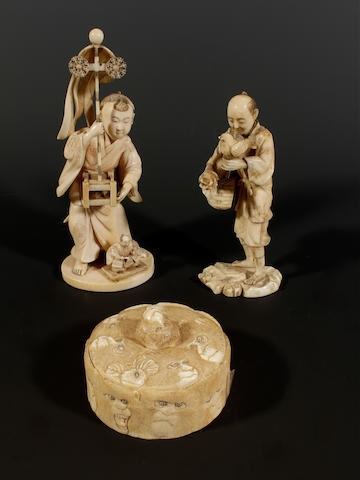 Two Japanese carved ivory figures and a small box and cover, Meiji period