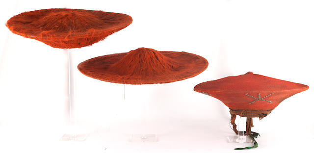 Three Zulu red-dyed headdresses, inhloko