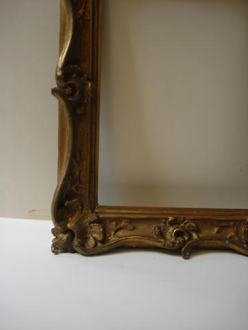 A Venetian 18th Century style carved and gilded panel frame