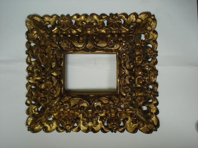 An Italian 19th Century carved, pierced and gilded frame