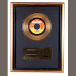 Wham!: An RIAA 'Gold' award sales for the single 'Wake Me Up Before You Go-Go', presented to Andrew Ridgeley,
