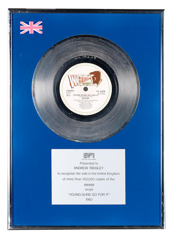 Wham!: A BPI 'Platinum' award for the single 'Young Guns Go For It', presented to Andrew Ridgeley,