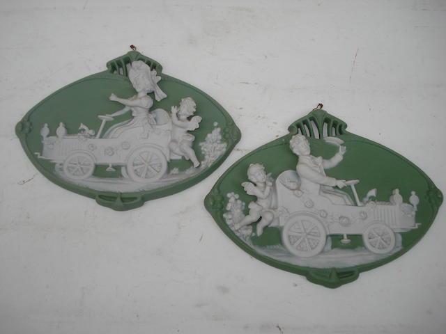 Two porcelain 'pate-sur-pate' motoring plaques,