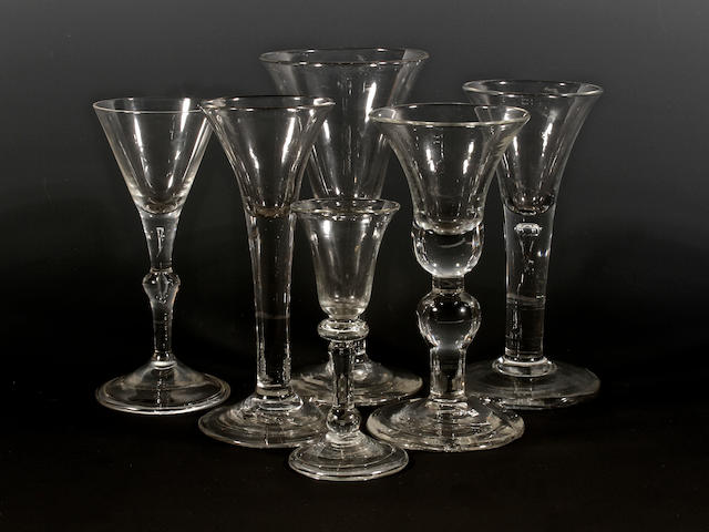 A Kit-Kat type wine glass, a gin glass, a baluster wine glass and three other wine glasses, circa 1720 and later