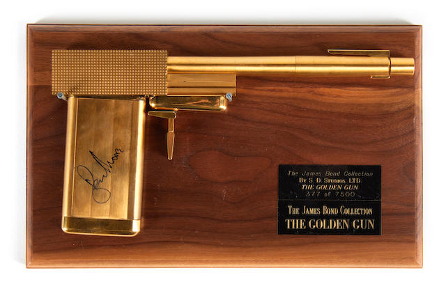 'The Man With The Golden Gun', 1974, a replica gun autographed by Roger Moore,
