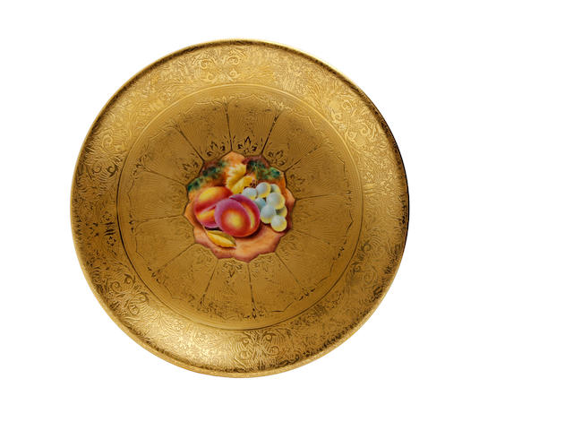 A Royal Worcester fruit painted and heavily gilded plate, signed Henry