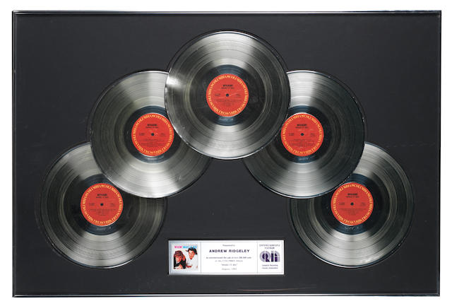 Wham!: Two Canadian 'Platinum' awards for the single 'Careless Whisper' and a Canadian 5x 'Platinum' award for the album 'Make It Big',   both presented to Andrew Ridgeley,