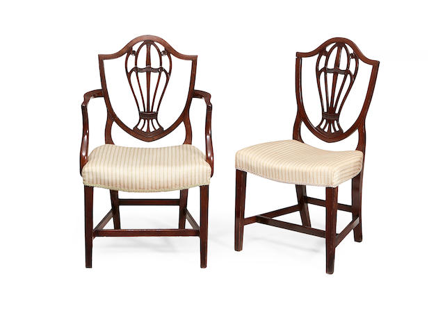 A set of twelve late 19th century mahogany shield back dining chairs