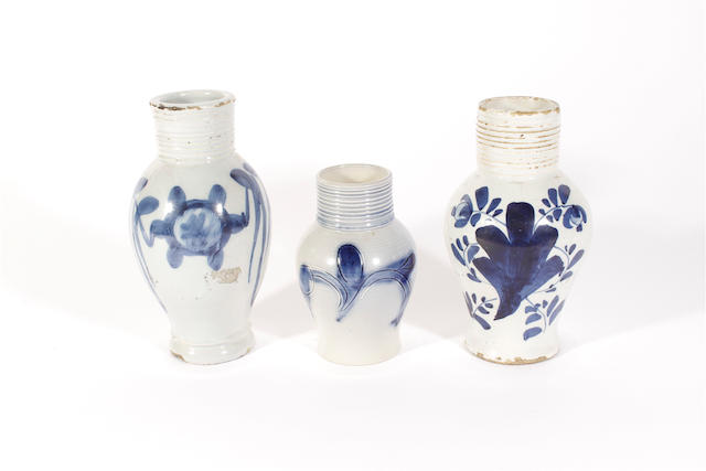 Two Vauxhall delftware tavern measures and a similar Staffordshire saltglaze measure, all late 18th century