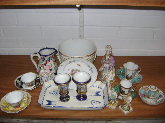 Collective ceramics comprising a Wedgwood pearlware fish dish, two small Staffordshire Putti figures, pair Coalport style vases with building vignettes, Meissen figure of a lady, Meissen plate, Vienna coffee cup and saucer, three cabinet cups and saucers, chamberstick, gaudy Welsh jug, cachpot, two small figurines (damage to some) (16)