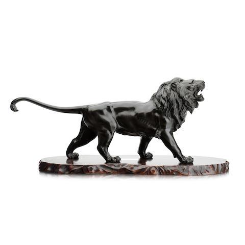 An impresive bronze lion by Atsuyoshi Meiji