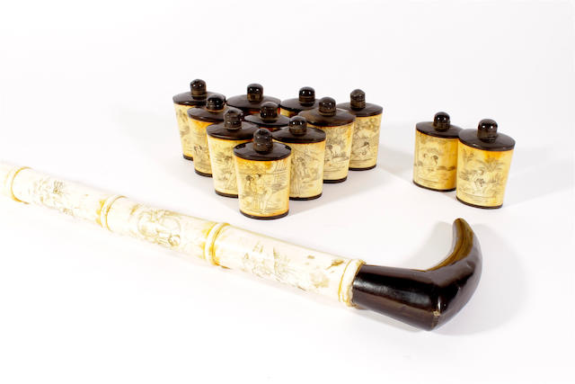 Twelve ivory and hardwood snuff bottles and stoppers and a walking stick