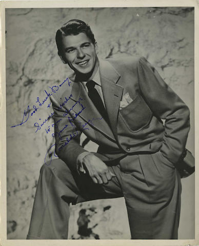 A collection of signed, vintage film star photographs,