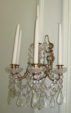 A pair of 19th century gilt brass and glass wall light fittings