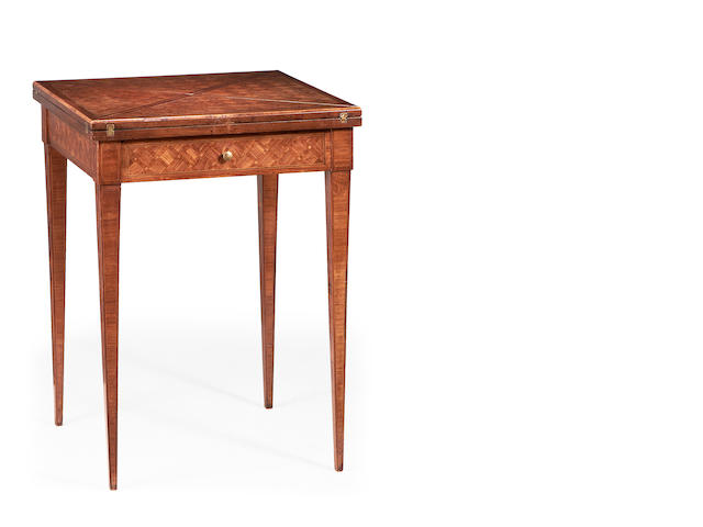 A French late 19th century mahogany and rosewood parquetry envelope card table in the Louis XVI style