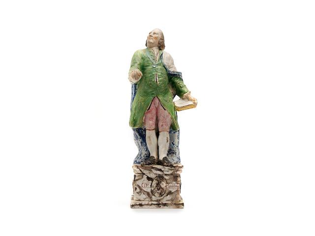 A Staffordshire figure of Benjamin Franklin 19th Century