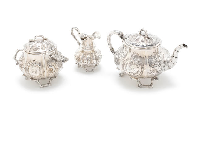 TIFFANY & CO: An American silver three-piece bachelors' tea service marked, Tiffany & Co, Late Tiffany, Young & Ellis. 550 Broadway, circa 1855,  pattern number 90 and order numbers 689 for the teapot and cream jug, sugar bowl with order number 1073  (3)