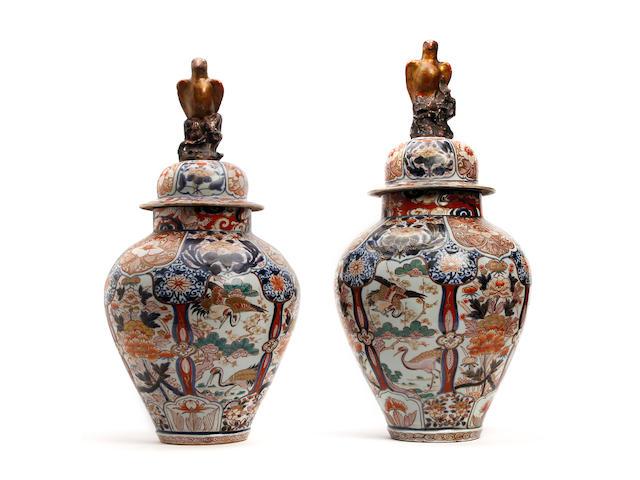 A pair of Japanese Arita baluster Jars and Covers Circa 1700