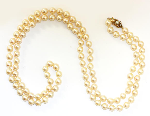 A single row uniform cultured pearl long necklace,