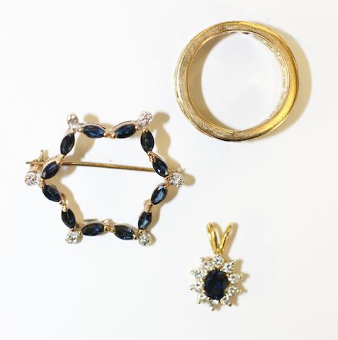A sapphire & diamond full hoop eternity ring, a sapphire garland brooch and a sapphire & diamond cluster pendant (3)