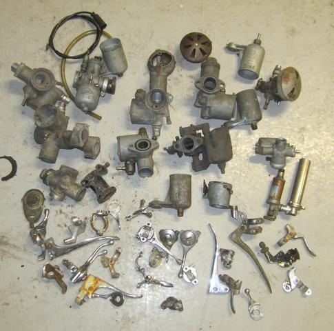 Assorted carburettors and control levers,