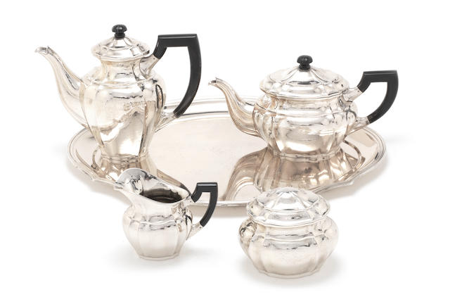A German silver four-piece tea and coffee service together with tray by Hermann Behrnd, incuse retailer's mark C E KEYSER, Leipzig  (4)