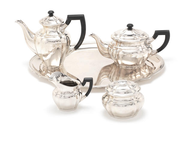 A German silver four-piece tea and coffee service together with tray by Hermann Behrnd incuse mark C E KEYSER, LEIPZIG