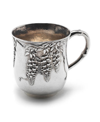 A 20th-century Japanese  metalware mug, stamped 'SHOKOSHA' below a crescent and star, also with character marks, circa 1930