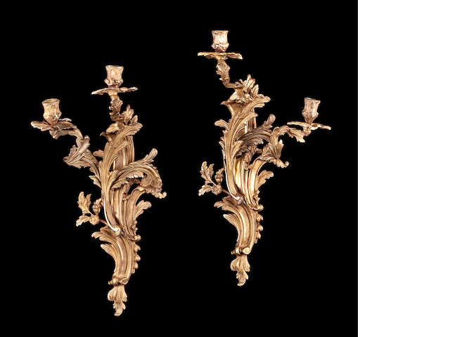 A pair of Louis XV style gilt metal wall lights