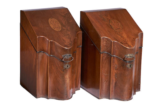 A pair of George III mahogany serpentine knife boxes