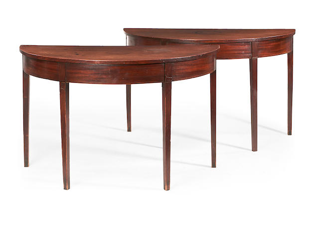 A pair of George III mahogany demi lune tables