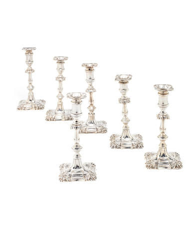 Six matched silver candlesticks in an 18th century style four by I.S. Greenberg & Co, Birmingham 1901 and two by Thomas Bradbury & Sons Ltd, Sheffield 1900  (6)