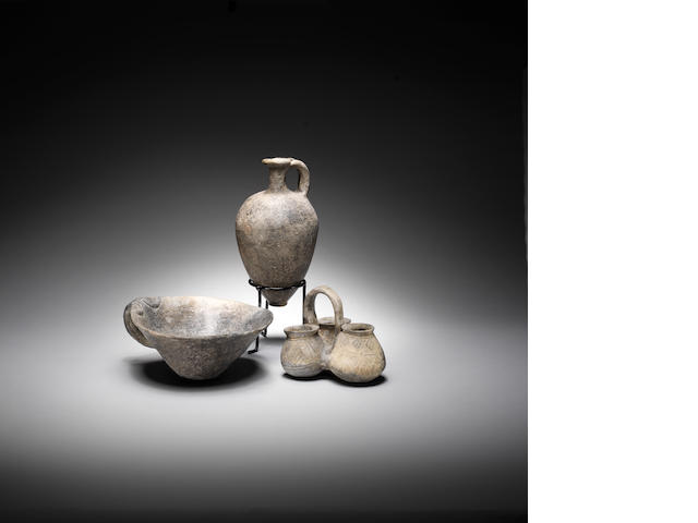 Three grey-burnished vessels 3