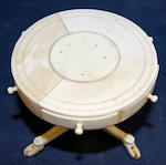 A 19th Century carved ivory miniature drum table