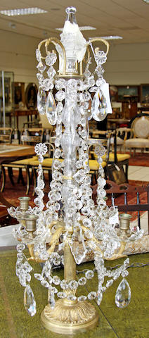 A pair of gilt metal and cut glass candelabra