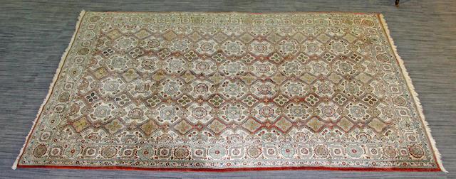 A Ghom carpet 324 x 223cm