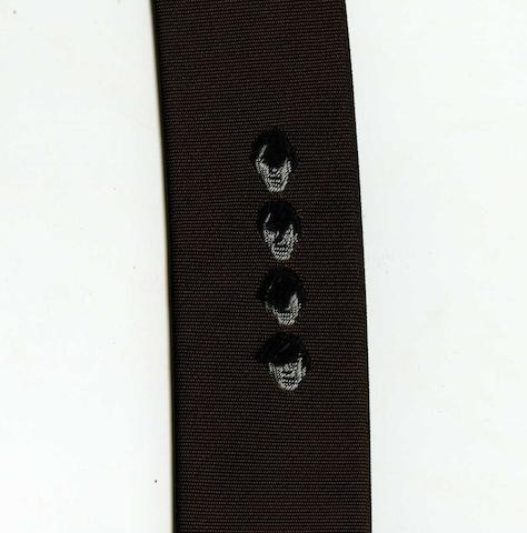 The Beatles/ Brian Epstein: A tie with Beatles motif and leather belt, 1960s,