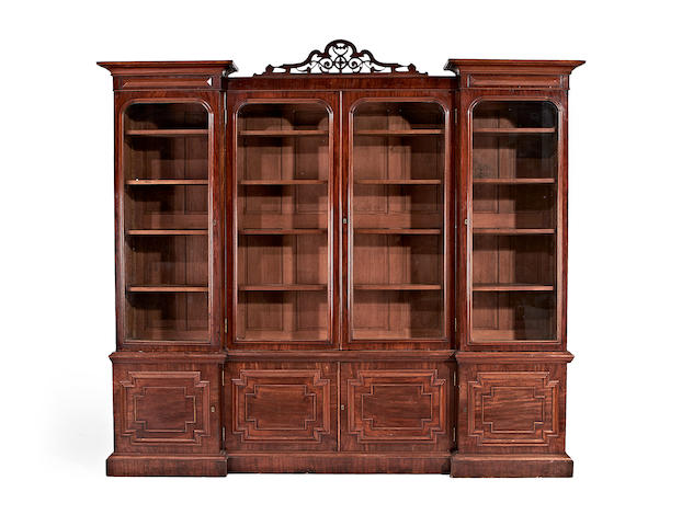 A William IV mahogany inverted breakfront library bookcase in the manner of Richard Bridgens
