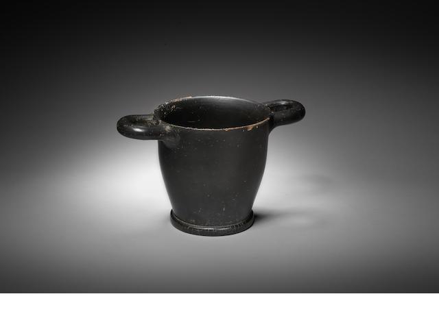 a 2 handled black glazed skyphos, c 4 century BC