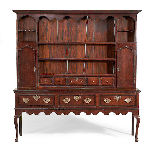 A George II oak and mahogany banded dresser