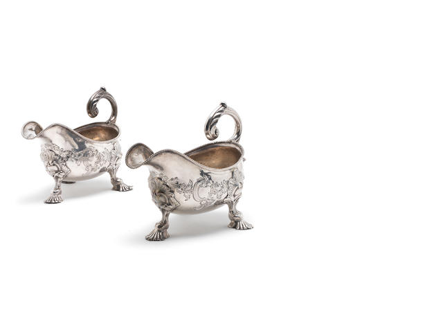 A pair of George III silver sauceboats maker's mark overstriking another and both sets distorted London 1772  (2)