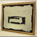 A reproduction Rolls-Royce 'The Best Car in the World' advertising mirror,