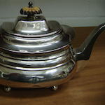 A George III silver teapot of oblong rounded form, on ball feet, 1816, 15oz (all in)
