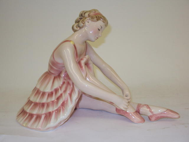 An Austrian Keramos figurine of a seated ballerina