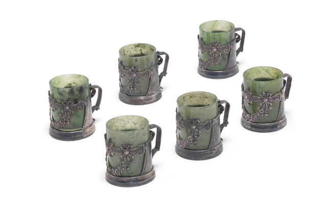 Set of six mugs with pierced silver garlands that hold green stone cups