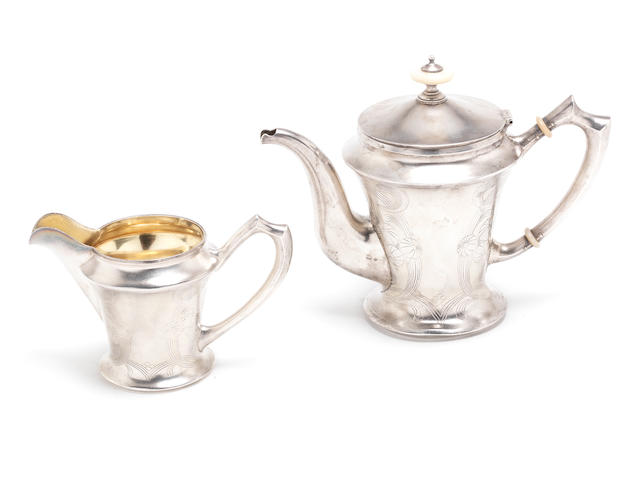 A Russian silver teapot and cream jug Maker's mark in Cyrillic AИ, 1896 - 1908 kokoshnik marks  (2)