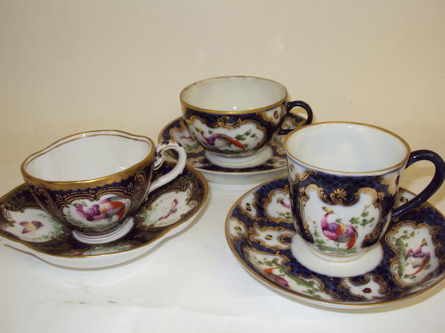 Three English decorative teacups and saucers