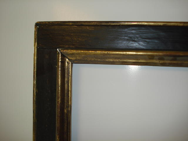 A Spanish style 20th Century ebonised and parcel gilt frame